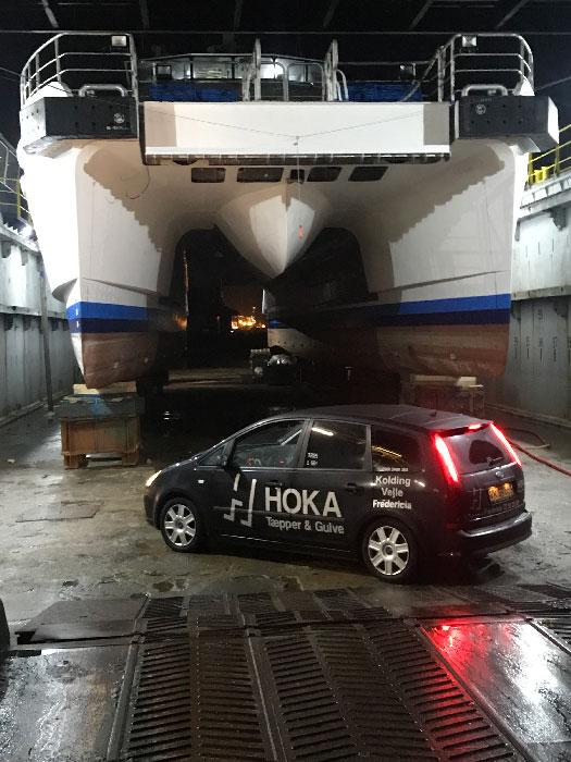 montering af tæpper på skibe